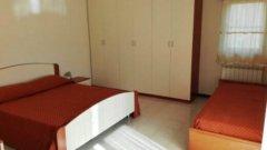 09.AppartamentoPanoramico_CameraLetto.jpg